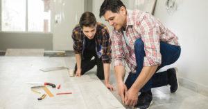 Two people doing floor installation