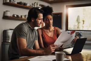 A couple reviewing vinyl flooring options