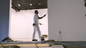 Man painting in Urban Surfaces' Southern California Showroom