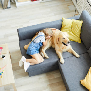 Young girl hugging a dog in their pet-friendly apartment home