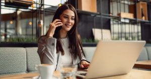 Woman talking on the phone and doing remote work at a multifamily property